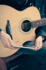 You can sit on your home computer or on a mobile device and do online guitar lessons.